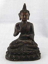 A bronze figure of a seated Buddha. Ht.17cm.