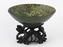 A turned moss agate bowl. 9cm dia. on hardwood