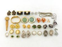 A collection of costume jewellery, comprising mostly ear clips and pendants, together with an Elizabeth Taylor Collection and Versace box