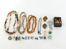 A mixed lot comprising a quantity of white metal and costume jewellery, a bone seal, a Russian lacquer box and a gilt metal owl box.
