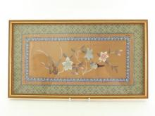 A Chinese embroidered textile on silk with frame. Beautifully woven on golden silk ground with sinuous morning glory, and with a bird standing on the branch, settled in a blue and white floral border. 20th century.  44cm* 25cm. In good condition