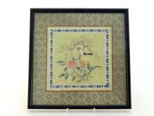 A Chinese square embroidered textile on silk with frame. Beautifully woven on golden silk ground with pine tree, peony, and a bird standing on the branch, settled in a blue and white floral border, 20th century. 29cm*29cm. in good condition.