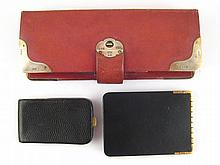 A red leather Bridge card set with silver mounts