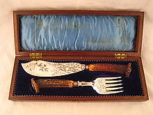 A pair of silver plated fish servers with antler
