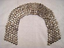 A white metal, untested, long dress ornament ,
