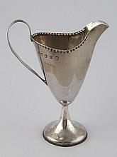 A Georgian silver helmet cream jug with strap