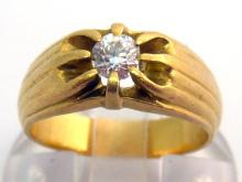 An 18 carat gold and diamond single stone ring, the central old brilliant approx. 0.25 carat, to fluted shoulders, French poincon, finger size K, 6.7gms