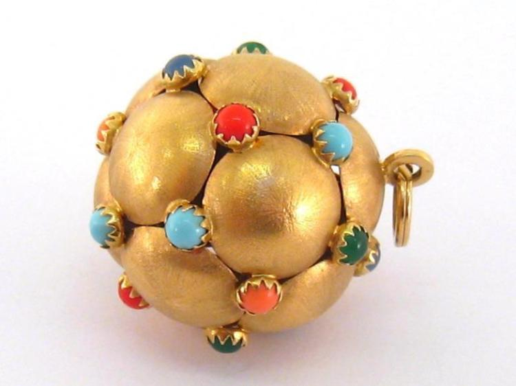 An Italian 18 carat gold pendant, the spherical hollow pendant composed of textured domed pads, with claw set coloured glass cabochons between, the bale with Italian standard marks, 26mm diameter, 10.9gms