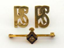 A pair of yellow metal (tests 14 carat gold) cuff links, the links cut as open work monogram 'RS', swivel bar fittings, 10gms, together with a late Victorian gold and enamel City Livery bar brooch, marked '18ct', 2.9gms