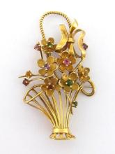 A multi gem giardinetto brooch, the openwork basket and flowers design set with small round cut stones, stamped '585' and maker's mark 'ST', 5.3cm long, 8.3gms