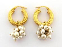 A pair of 9 carat gold and cultured pearl ear hoops, each small hoop suspended with a bunch of small pearls, 7.8gms