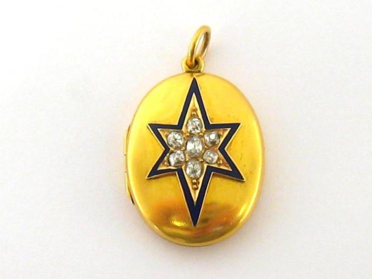 A Victorian diamond and enamel locket, the oval two piece hinged case set to the front with a star of mine cut stones, in a blue enamel border, engraved with a monogram verso, the case testing 18 carat gold, 29mm long, 9.7gms