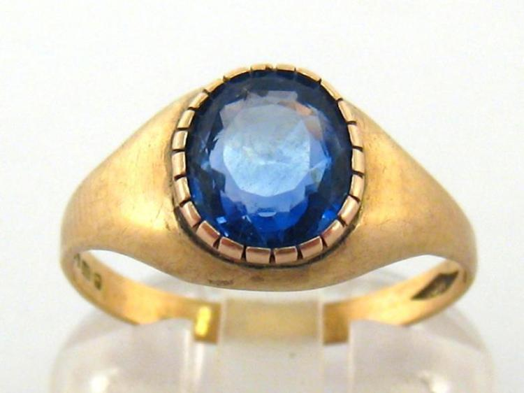 A gentleman's sapphire dress ring, the interesting oval mixed cut stone 7.9 x 7.4 x 4.2mm, mounted in 9 carat gold, fully hallmarked, finger size R, 2.5gms