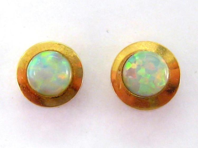A pair of synthetic opal ear studs, the small rub over set stones 4mm diameter, stamped '14k', butterfly fittings, 1.8gms