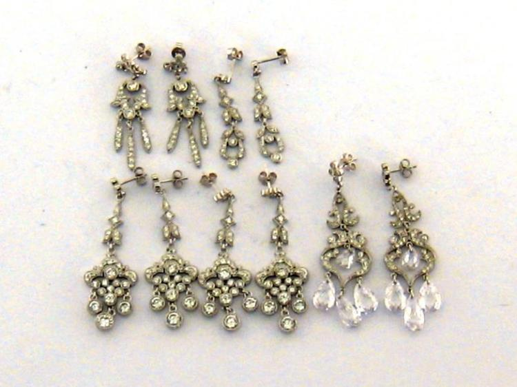 A collection of rhodium plated silver and crystal set chandelier earrings by Andrew Prince, various designs (5) Andrew Prince is celebrated as jewellery designer for television and films, and his designs can be seen on shows such as 'The Young Victoria' and 'Downton Abbey'.