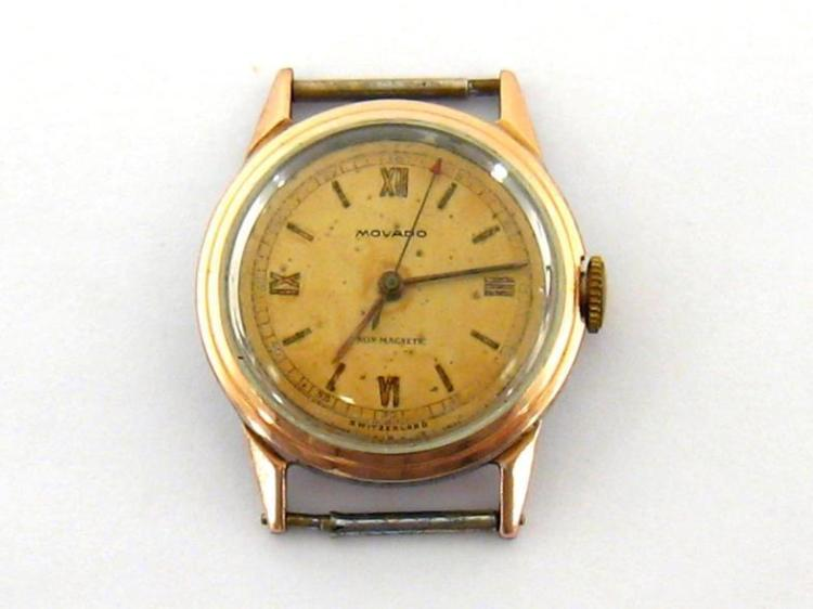 Movado, a 1950s stainless steel manual wind wristwatch, no. 0477602/14761, with rose gold topped bezel, the gilt dial with gold painted Roman and baton markers, and red arrow centre seconds, with signed 15 jewel movement, 30mm diameter, no strap