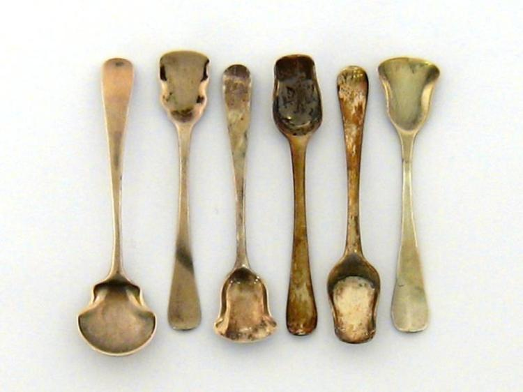 Six silver shovel bowl condiment spoons, comprising:- a Hanoverian pattern example initialled