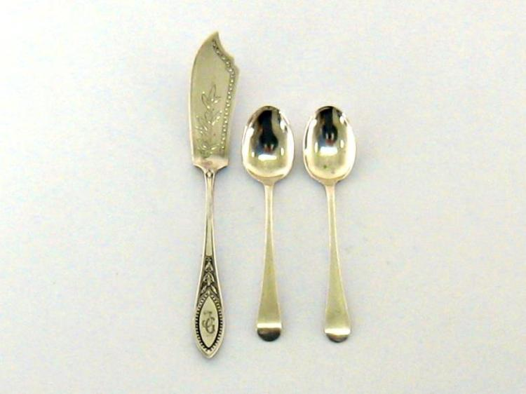 A German silver butter knife, the celtic point handle with laurel and bead decoration, bright cut engraved, by H. Schnaper, Hamburg, German 800 assay, together with a pair of Old English pattern silver teaspoons, Levi and Salaman, Birmingham, 1922.