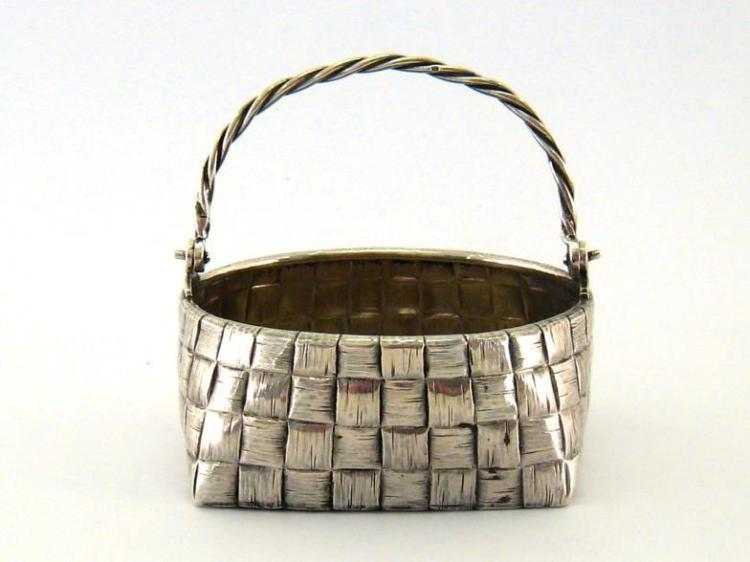 A Russian silver trompe l'oeil sugar basket, maker's mark P.D (Cyrillic), St. Petersburg, 1899/1908, with ropework swing handle and basket-weave sides and base