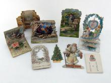 A collection of seven 19th. century German stand-up three dimensional Christmas cards, together with  an envelope containing a home-made set of six cards with numbers for a counting ?Puzzle?, with handwritten instructions. (8)