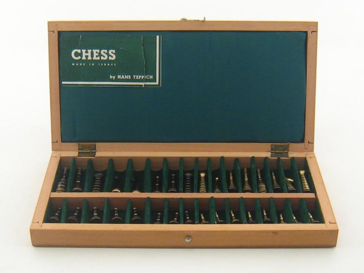 A Hans Teppich travelling chess set, the wooden case opens t