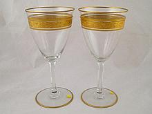 A pair of Baccarat glass goblets with gilt bands,