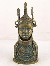 An African cast bronze torso with ceremonial