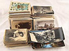 A large collection of loose postcards, mainly
