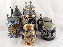 Six lidded German steins and an unlidded example.