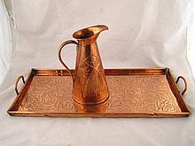 An Arts and Crafts copper two handled tray chased