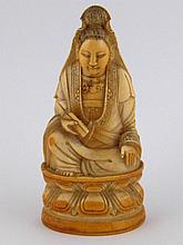 A Chinese ivory figure of Guanyin seated on a