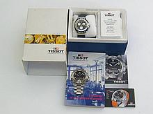 Tissot, ?T-Race?, a gentleman?s stainless steel and rubber quartz chronograph wristwatch, ref. T472 no. TKQ-JA-18155, the black dial with orange markers, three subsidiary seconds dial registering hours and minutes and running seconds, magnified date aperture at 3 o?clock, (movement not functioning), the case 4cm diameter, a rubber leather strap, with box and paperwork
