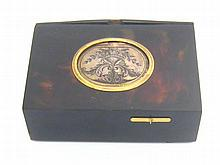 A 19th. century gilt metal mounted tortoiseshell singing bird musical box operated by a sliding  lever releasing a bird with moving wings and beak from beneath an engraved silver cover, a rear compartment for the key. 6.5x9.5x3cm. high.