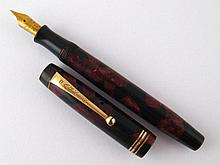 A Parker Duofold fountain pen in shades of black