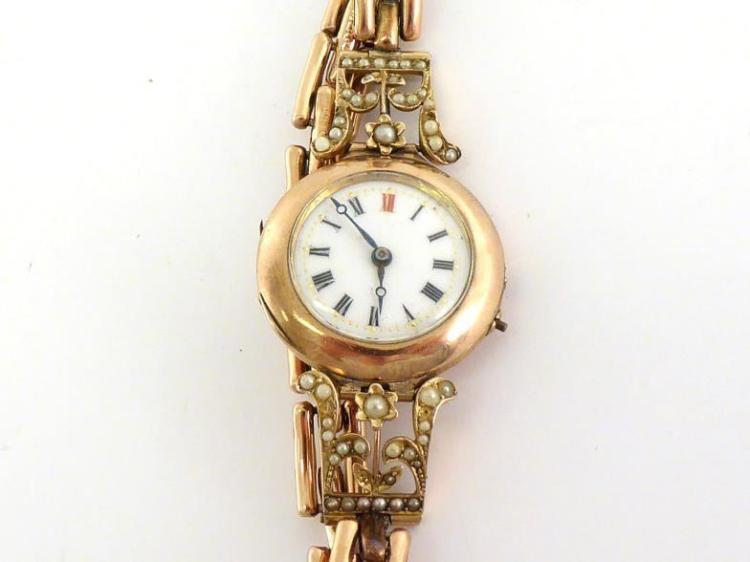 An Edwardian 9 carat gold manual wind wristwatch, the two pi