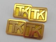 A pair of yellow metal (tests 9 carat gold) cufflinks, the links with raised initials 'TK' on a canted rectangular ground, chain connections, 9.1gms