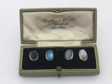 A pair of moonstone cufflinks, the oval cabochon stones mounted in white metal (tests silver), 7.9gms