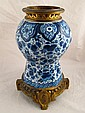 A Dutch delft ceramic lamp base with fitted gilt