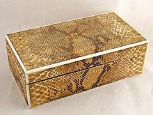 An Art Deco lizard skin and ivory mounted box,