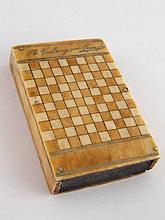 An ivory vesta case, decorated as a chess board,