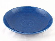 A Chinese ceramic deep blue bowl with incised