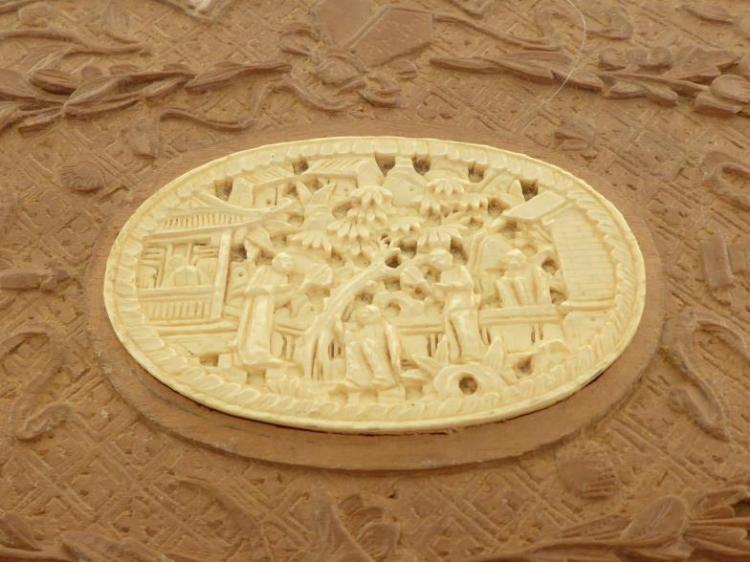 A chinese carved hardwood box cover inset with oval bone pl