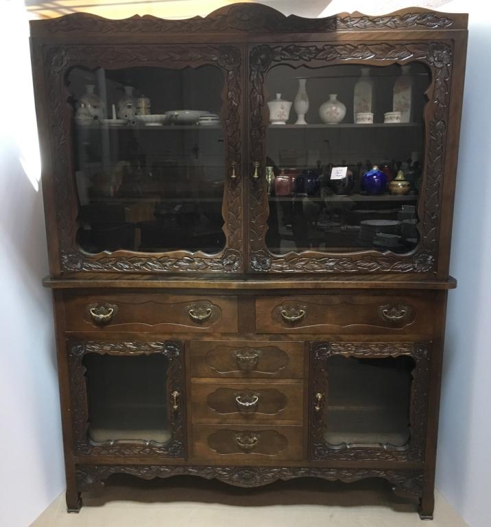 Carved dark wood china cabinet