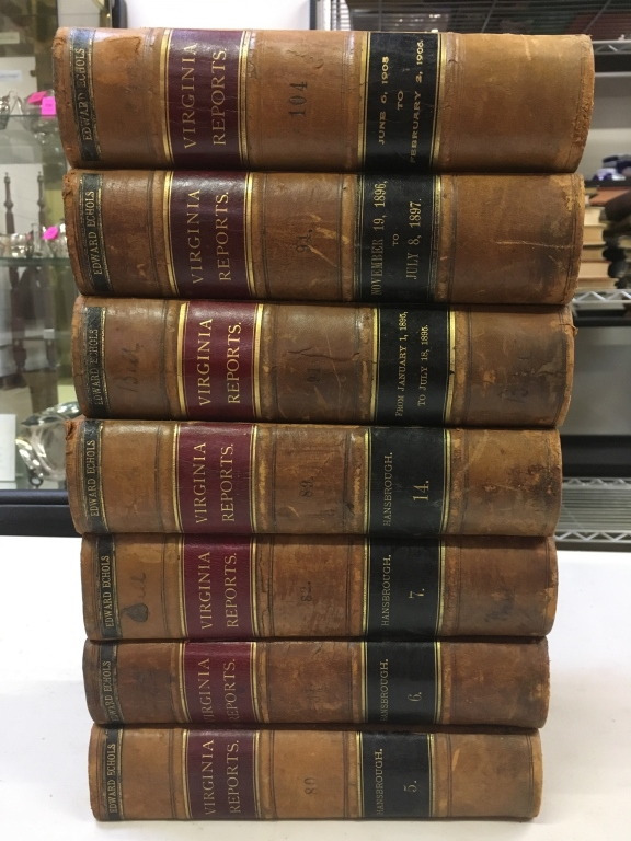 SEVEN LEATHER BOUND VOLUMES OF