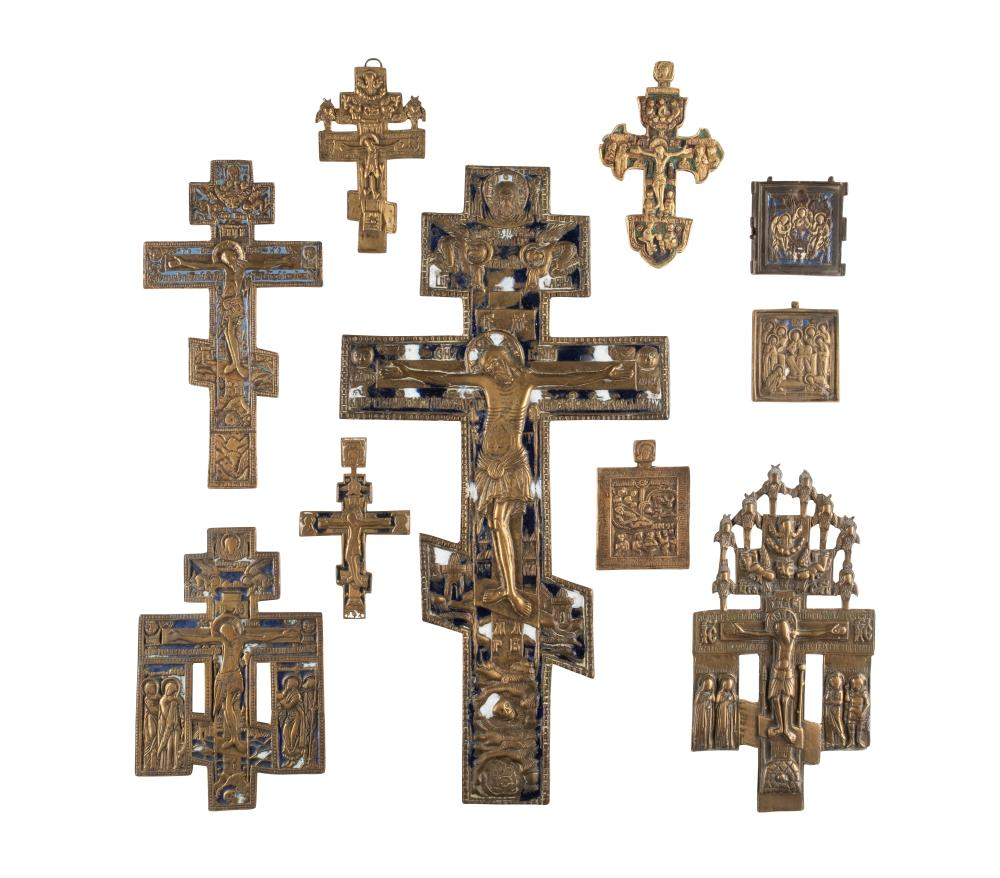 SEVEN CRUCIFIXES AND THREE BRASS ICONS AND FRAGMENTS