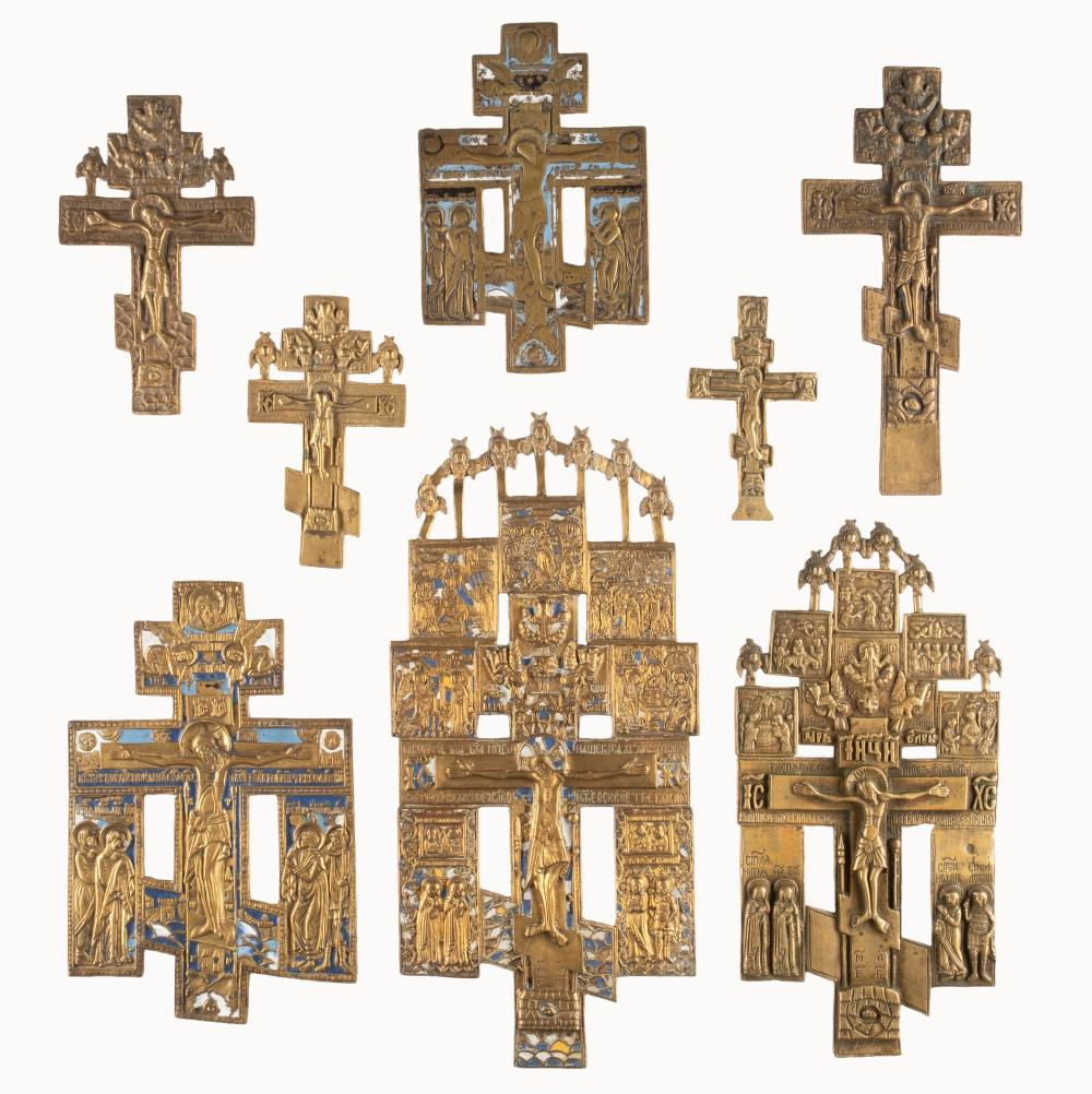 A COLLECTION OF EIGHT BRASS CRUCIFIXES