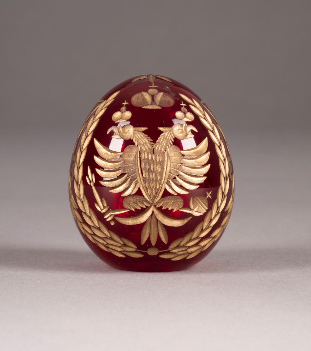 A GLASS EASTER EGG WITH DOUBLE-HEADED EAGLE AND IMPERIAL CY
