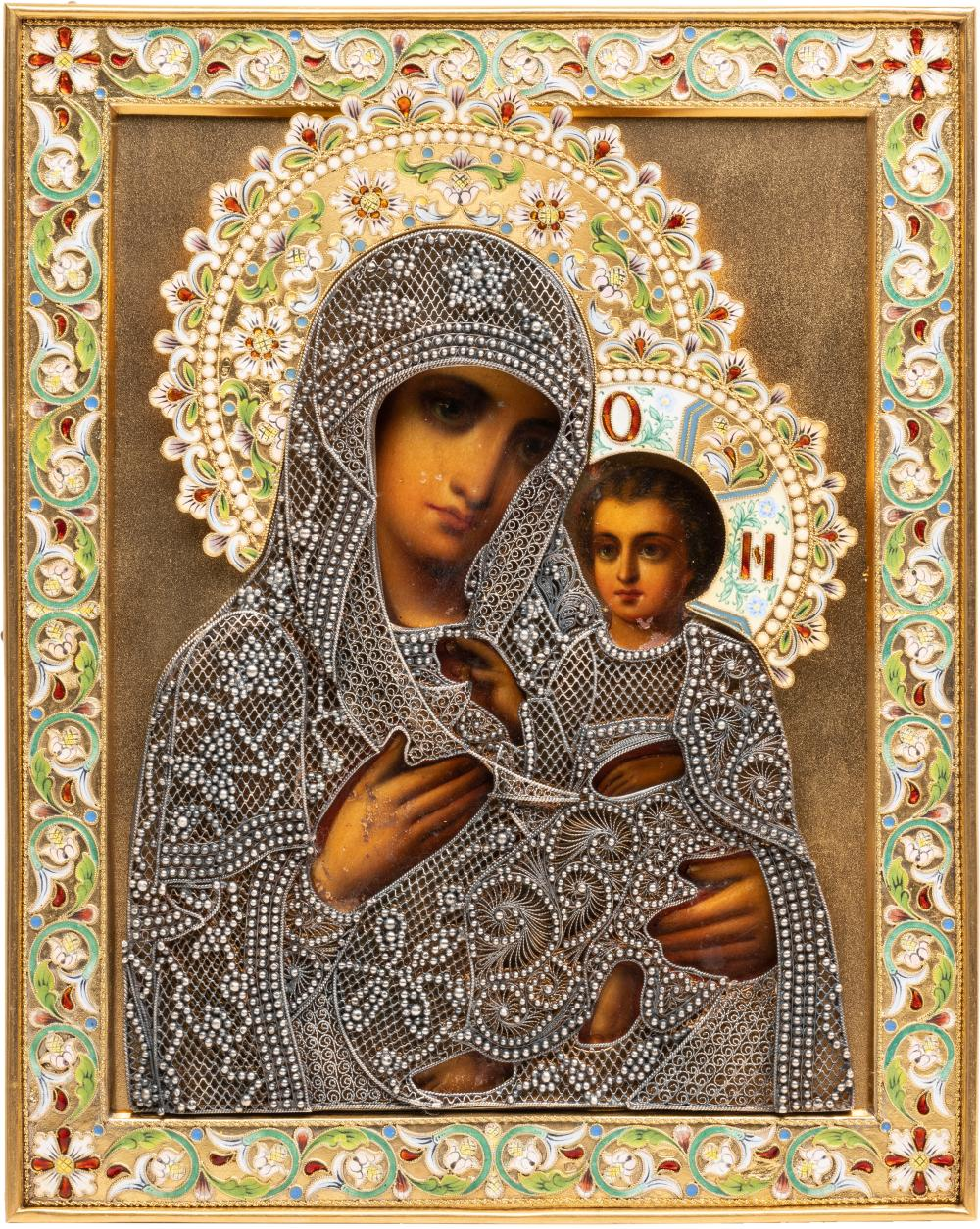 AN ICON SHOWING THE TIKHVINSKAYA MOTHER OF GOD WITH A SILVE
