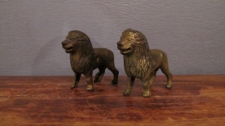 56.  Pair of Cast Iron Lion Still Banks