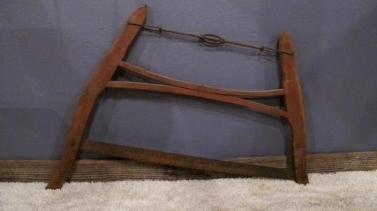 67. Antique Buck / Bow Saw